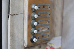 Old intercom buttons on building facade Stock Images