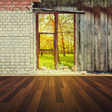Old interior with brick wall and window Royalty Free Stock Image