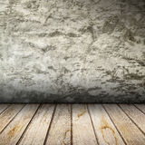 Old interior with concrete wall and wooden floor. Royalty Free Stock Images