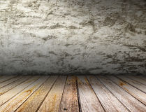 Old interior with concrete wall and wooden floor. Royalty Free Stock Image