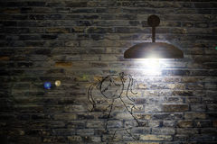 Old interior room with brick wall and three light spots Royalty Free Stock Photography