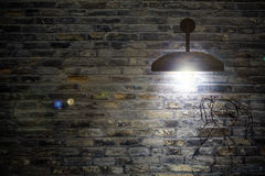 Old interior room with brick wall and three light spots Royalty Free Stock Photo