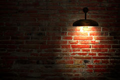 Old interior room with brick wall and three light spots Stock Image