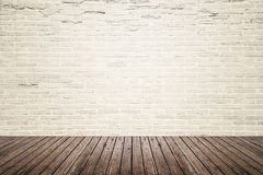 Old interior room with brick wall and wood floor Royalty Free Stock Photography