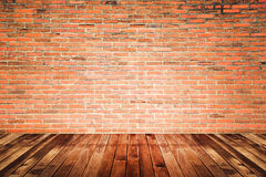 Old interior room with brick wall and wood floor Stock Photos