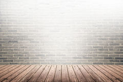 Old interior room with brick wall and wood floor stock photo