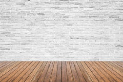 Old interior room with brick wall and wood floor. Old interior room with broken white brick wall and grunge wood floor texture Royalty Free Stock Images