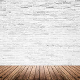 Old interior room with brick wall and wood floor Royalty Free Stock Photos