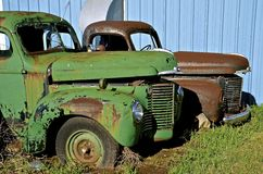 Old International Pickups. MANDAN, NORTH DAKOTA, July 1, 2016: The old International pickup s with partially open hoods are a product of the International royalty free stock images