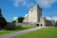 Old Irish castle. Killarney Castle (Ireland) at a sunny day. At that early daytime no visitors were present Stock Photo