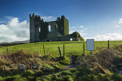 Old Irish castle ruins in a sunny day during noon Stock Photos