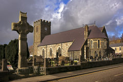 An old irish church. An old church and cross with a very moody sky Royalty Free Stock Image