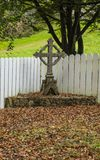 The Old Cross. An old Irish cross with leaves Stock Images