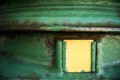 Old irish postbox copyspace. Old green irish postbox with copyspace on yellow label Stock Photo