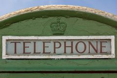Detail of an old telephone booth with british crown. Dublin. Ireland. An old irish telephone booth with a british crown. Dublin. Ireland Royalty Free Stock Image