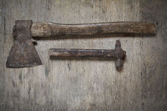 Old iron ax and old iron hammer Royalty Free Stock Photography
