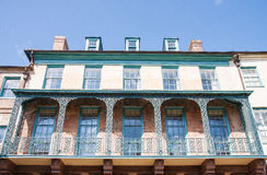Old Iron Balconies on Yellow and Green Building Royalty Free Stock Images