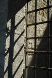Old iron bars door and sunlight Royalty Free Stock Photo