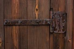 Old iron bolt. On a wooden door Stock Photos
