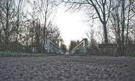 Old iron bridge. Old road. Pass of the time Royalty Free Stock Image