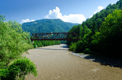 The old iron bridge over the river - color Stock Photography