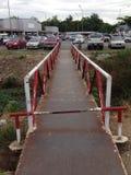 Old iron bridge to the parking Stock Photo