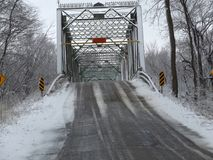 Old iron bridge in western Indiana. During a break in the snow from late March snowstorm stock image