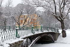 Old Iron Bridge. Winter scene - Old iron bridge in winter snowy park Royalty Free Stock Photography