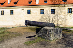 Old iron cannon on a pedestal in Bauska town, Latvia Royalty Free Stock Images