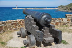 Old iron cannon pointing at sea Mediterrean France Royalty Free Stock Images