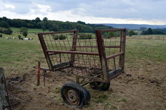 Old iron cart with tires to burst. Old iron cart with tires to burst to put in one fields Stock Photo