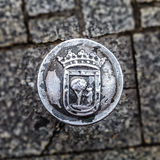 Old iron cast roadblock column with symbol of Madrid Royalty Free Stock Image
