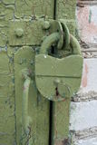 Old iron castle, covered with green paint. Old iron lock on the door. Castle green painted Royalty Free Stock Image
