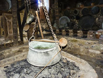 Old Iron Cauldron Pot and Spoon Stock Image
