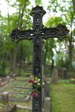 Old iron cross. An old iron cross decorates a grave at a cemetery in Vilnius, Lithuania Royalty Free Stock Photography