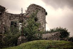 Old Iron Cross Standing in Medieval Castle Ruins Royalty Free Stock Photos