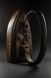 Old iron on a dark background. With a strong metal texture Royalty Free Stock Image