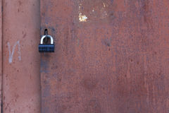 Old iron door with black lock Royalty Free Stock Photography