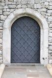 Old iron door in the castle Stock Photo