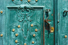 Old iron door, forged and painted in green color with golden flowers for background, vintage style, retro elements Stock Image