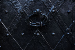 Old iron door. Door knocker on old iron door Royalty Free Stock Photography