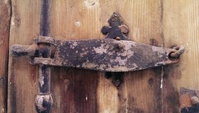Old iron door latch Royalty Free Stock Images