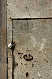 Old iron door and lock. Old iron door with a padlock and handle stock images