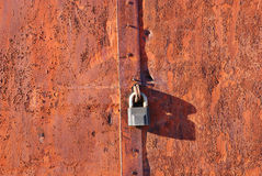 Old iron door with lock  rust Royalty Free Stock Image