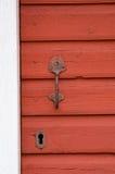 Old iron doorhandle. Old door handle at a red painted door Stock Photo