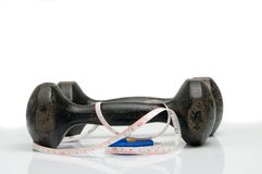 Old iron dumbbells and tape measure Royalty Free Stock Images