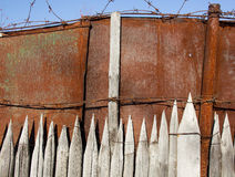 Old iron fence. Old garden fence upholstered metal royalty free stock photo