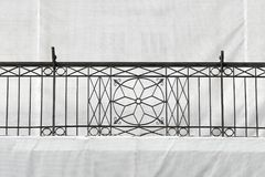 Old iron fence in Timisoara. Vintage cast iron fence at balcony of old building in reconstruction under protective canvas in Timisoara Romania Europe royalty free stock photography