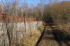 Old iron fence. Old upholstered iron fence. Autumn landscape Royalty Free Stock Images