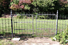 The old iron garden gate. Antiquie iron garden gate with path Stock Photo